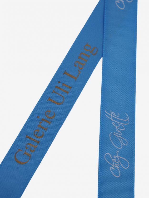 geschenkband-bedruckt-mit-firmenlogo-blau
