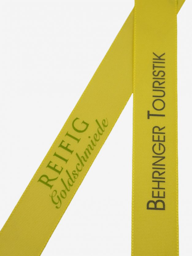 geschenkband-bedruckt-mit-firmenlogo-gelb