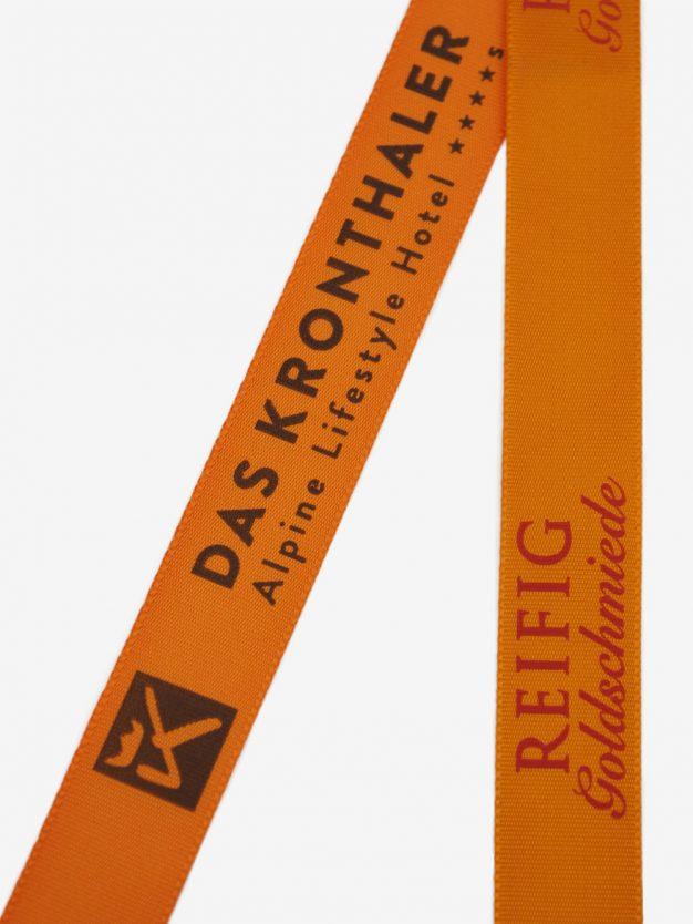 geschenkband-bedruckt-mit-firmenlogo-orange