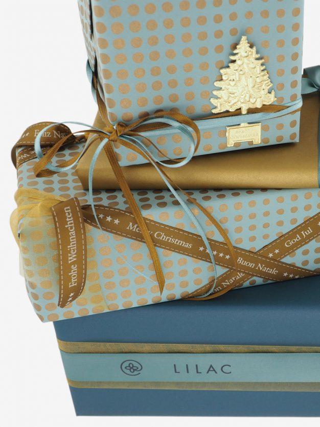 geschenkpapierpaeckchen-tuerkis-mit-punkte-gold