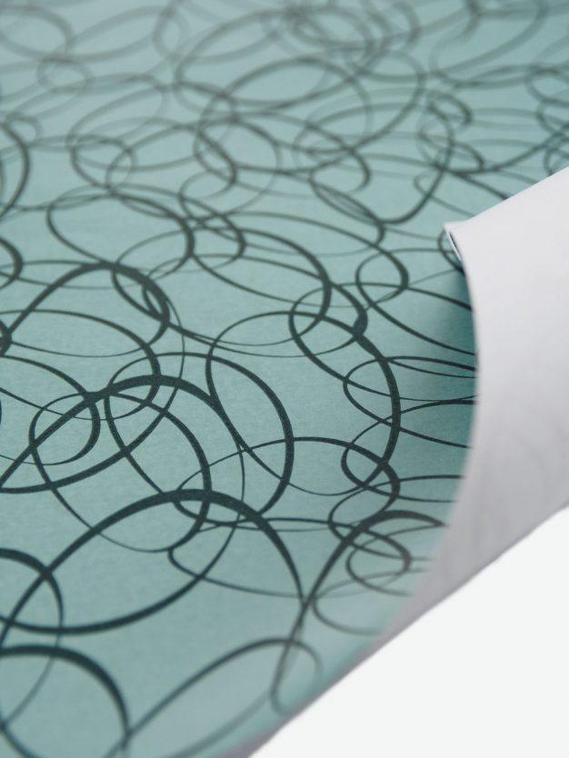 geschenkpapierbogen-tuerkis-umit-ovale-dunkelgruen